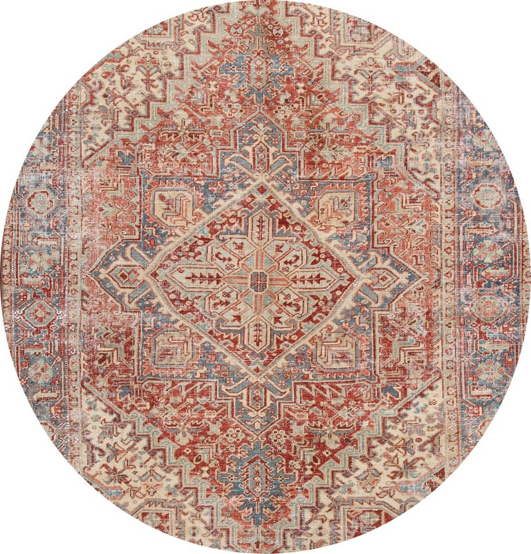 Beautiful 20th century vintage Heriz wool rug with a rust field, ivory, blue, and peach accents in the all-over multi-medallion design.