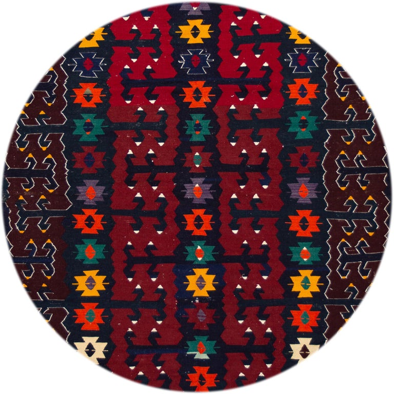 Beautiful vintage Persian Kilim rug, hand knotted wool with a red field, blue ad brown accents in all-over Classic tribal design, circa 1940. This rug measures 6' 2