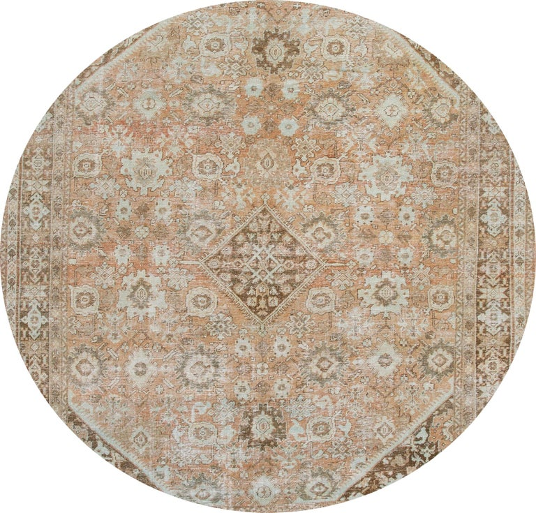 Beautiful vintage hand knotted Mahal wool rug with a peach field, brown, and ivory accents in an all-over geometric design.