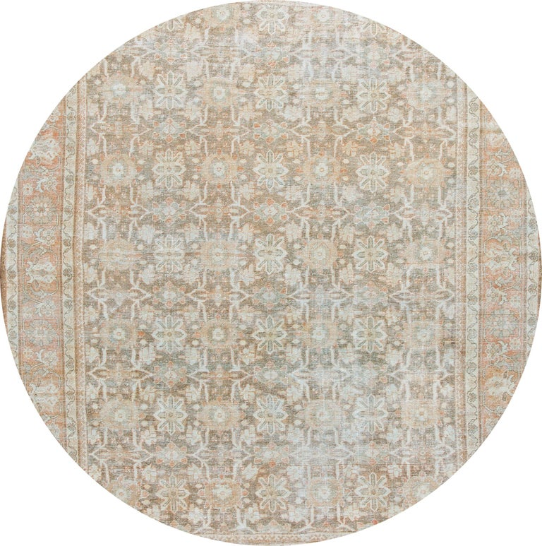 Beautiful vintage hand knotted Mahal wool rug with a brownfield, peach, blue, and ivory accents in an all-over floral design.