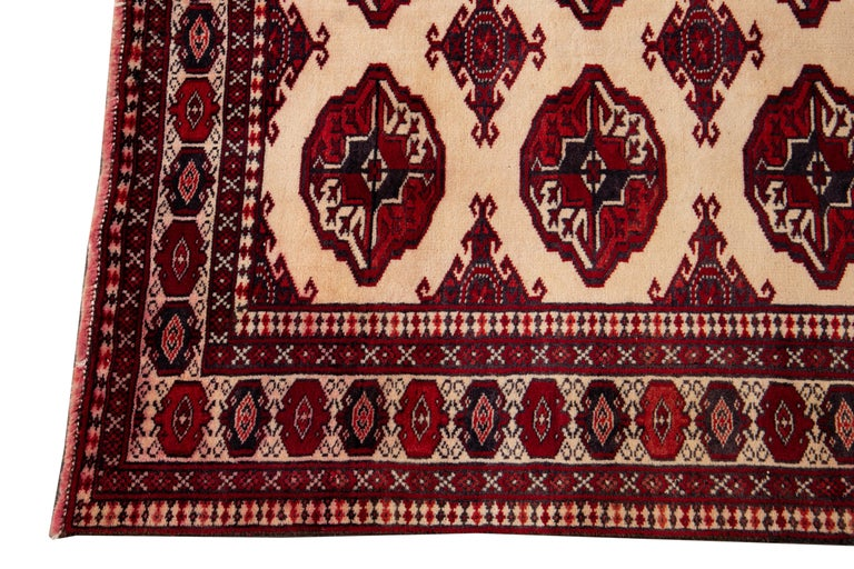 Beautiful vintage overdyed rug, hand knotted wool with an ivory field, red accents in an all-over geometric design, circa 1960. This rug 6' x 8'4