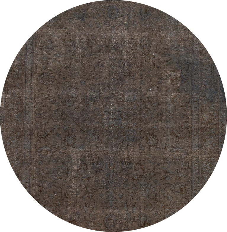 Beautiful vintage Overdyed rug, hand knotted wool with a gray field, subtle blue, and brown accents in a distressed floral design,