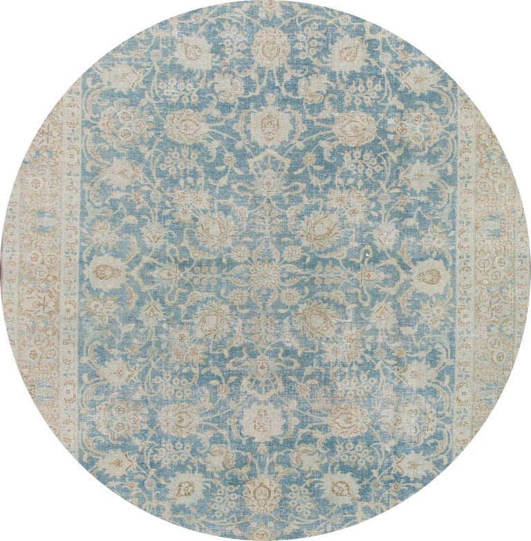 Beautiful 20th century vintage Tabriz wool rug with a light blue field, tan, and beige accents in the all-over floral design.   This rug measures: 7'1