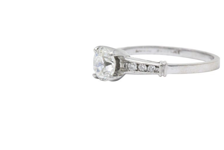 Centering an old European cut diamond weighing 0.85 carat, I color and SI clarity  Shoulders accented with six channel set single cut diamonds weighing 0.10 carat, eye-clean and white  Tested as platinum  Circa: 1950s  Ring Size: 7 1/2 &
