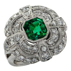 Mid Century 1.5 Carat Emerald and Diamond Ring