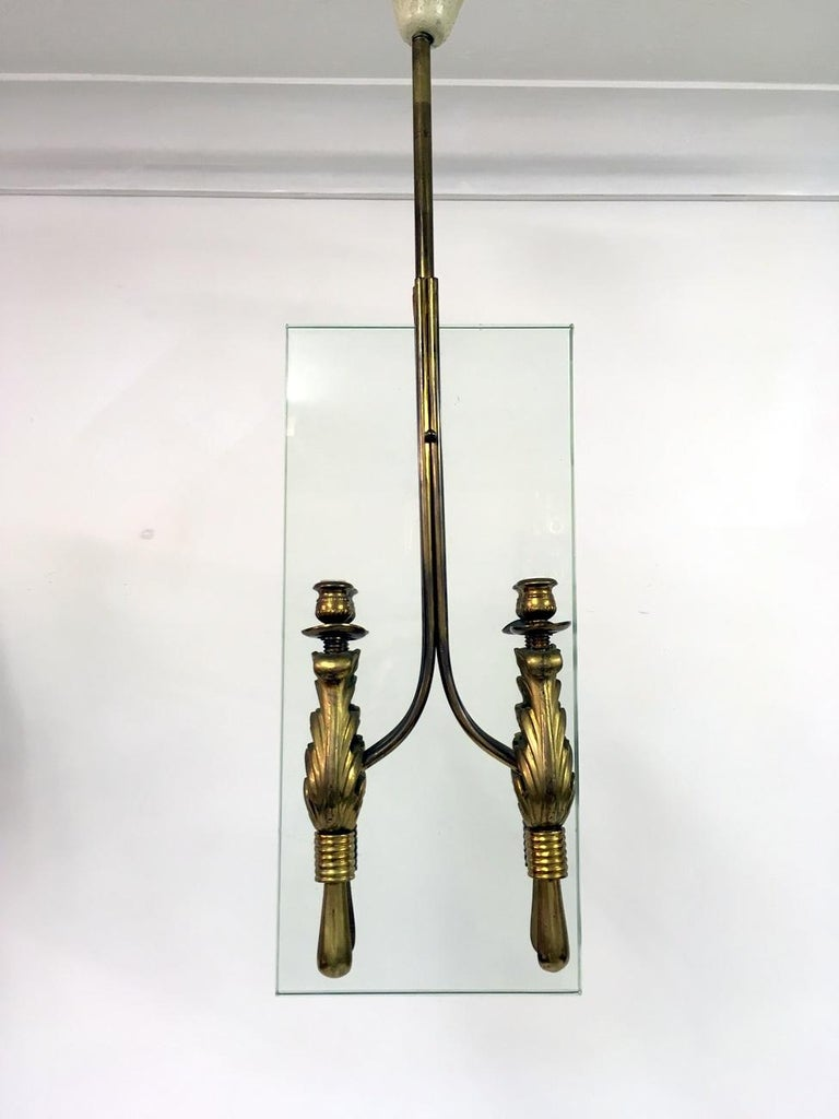 Hanging ceiling light Four lights either side of glass Brass fixtures  Thick rectangular glass Italian 1950s.