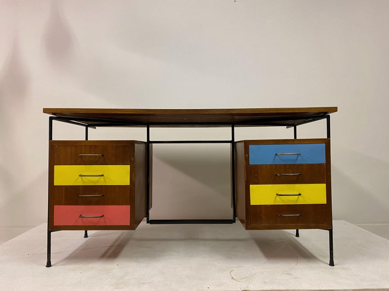 Desk by Giuseppe Postiglione  Colored laminate drawers and top  Enameled iron rod frame  Black painted brass handles,  Italian, 1950s.