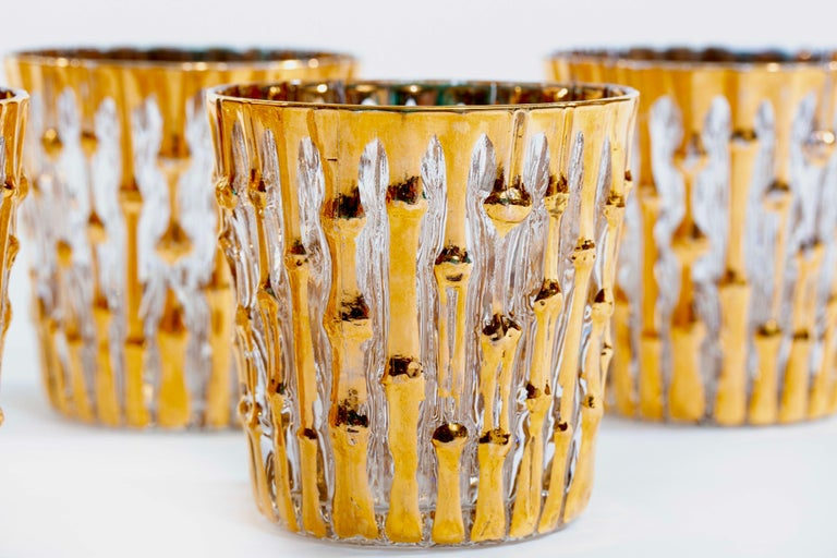 Grab them while they last! And they won't. Rare, and in excellent condition with no gold loss on rims - set of 22-karat gold hand painted bamboo pattern rocks glasses by the Imperial Glass Company. The bamboo pattern is embossed, meaning the glasses