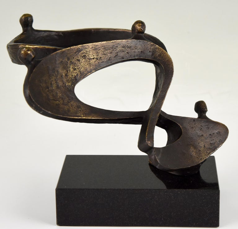 Mid-Century Modern bronze sculpture on a marble base, signed Can, circa 1970.
