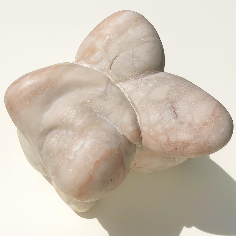 Mid-Century Modern abstract solid marble sculpture with biomorphic form. Extremely heavy. Unsigned, and likely mid-20th century. Marble has a soft matte honed finish and varies in color from white and ivory to pale pinks with beautiful veining. It