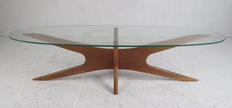 This beautiful vintage modern cocktail table features the iconic walnut