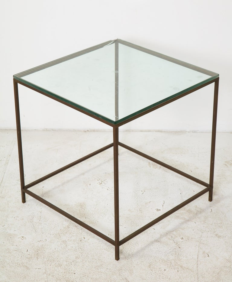 Midcentury American bronze and glass cube side table, circa 1950.