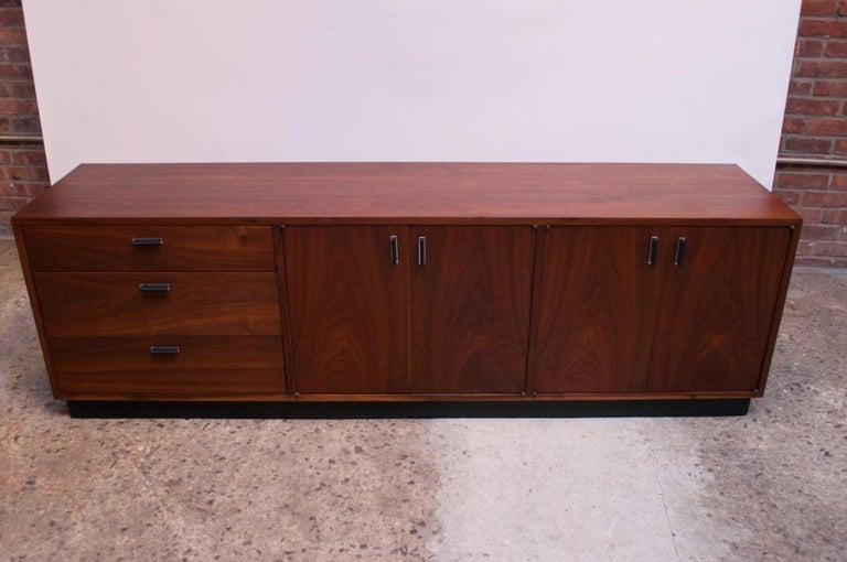 Mid-Century Modern Midcentury American Modern Walnut Credenza with Ebonized Plinth Base For Sale