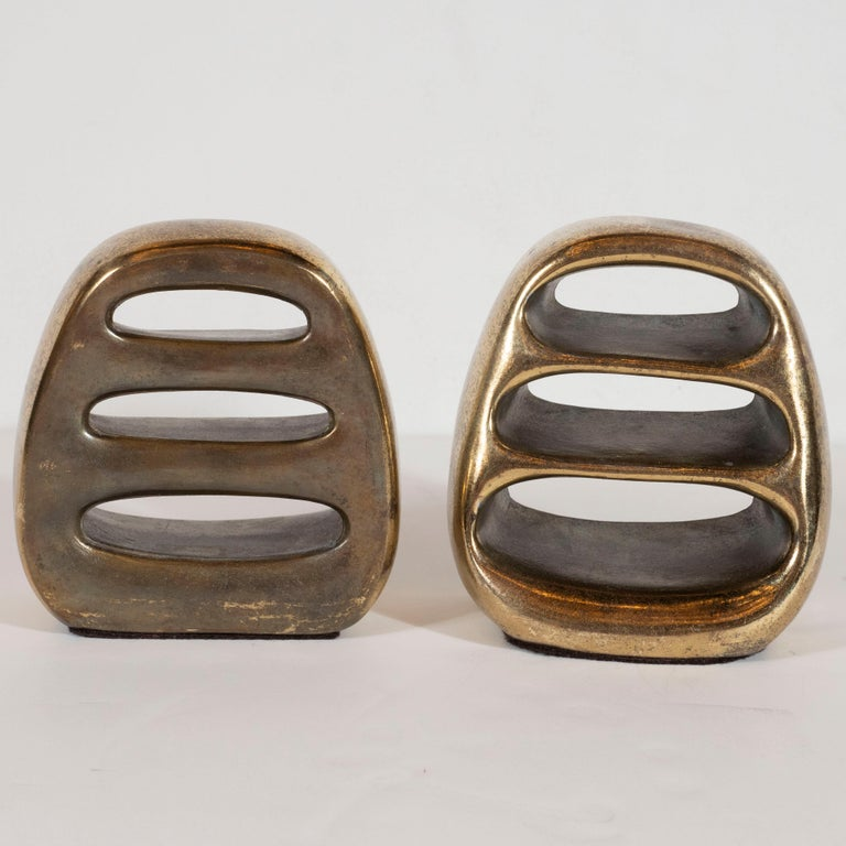 Midcentury Antique Gold Sculptural Bookends with Ovoid Cut Outs by Ben Seibel In Excellent Condition For Sale In New York, NY