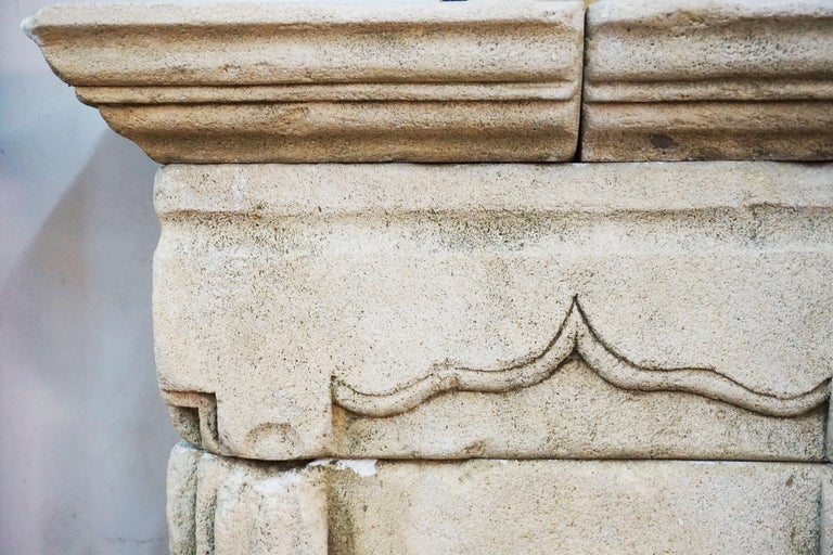 Antique limestone wall fountain features great hand carving details  Origin: France  Mid Century  Measurements: 29