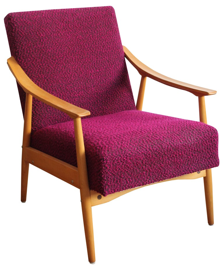 A midcentury armchair. Rare, unusual, comfortable and fun. That is probably the best way to describe this midcentury armchair.  The piece still has the original bright red/ pink fabric which creates a great contrast with the light tone of the