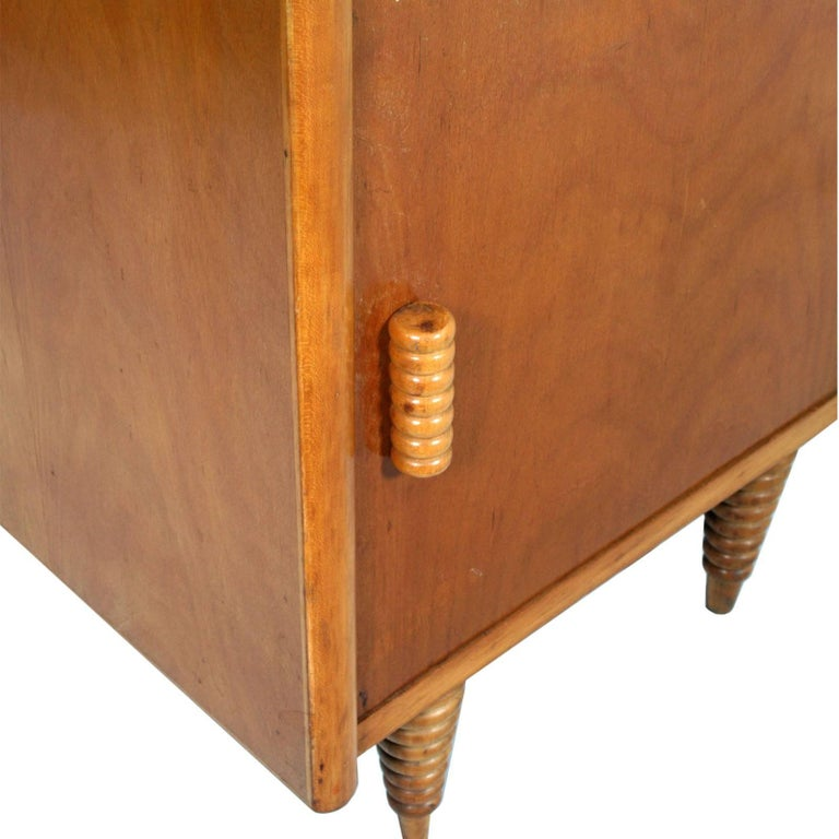 Italian circa 1930s Art Deco nightstand, Consorzio Esposizione Mobili Cantu, Gio Ponti attributed, in blond walnut and turned beech, polished to wax Measures cm: H54\62, W 45, D 35.  About this Gio Ponti's cabinet  This Ponti cabinet expresses all