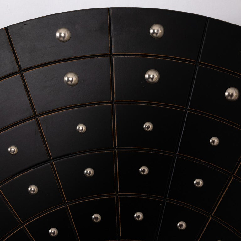 Round Art Deco style black painted wood frame mirror adorned with silver metal stud accents, circa 1970s. Please note of wear consistent with age including minor paint loss and scratches.