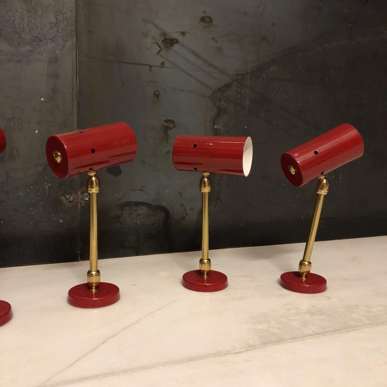 Set of four articulated spotlights with brass fixture manufactured in Italy during the 1950s. Excellent conditions. Measure: Height 23 cm.