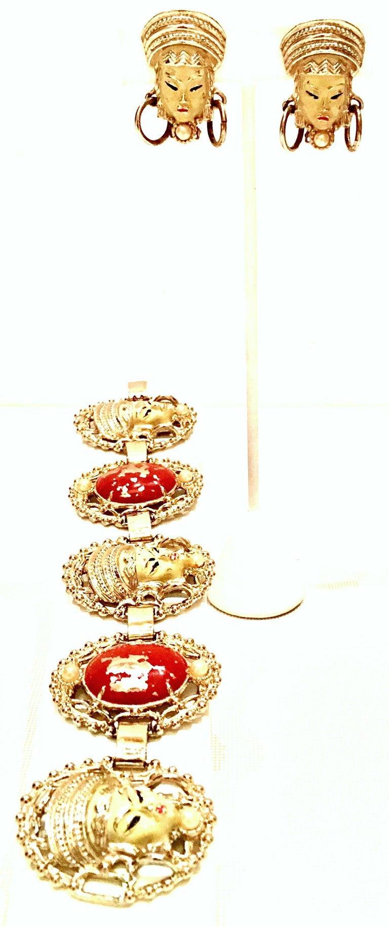 Mid-Century Selro style Asian Princess faux ivory and cinnabar gold plate five panel bracelet & Asian Princess Faux Ivory clip style earrings. The Asian Princes collection is well know for being unsigned but no doubt identifiable as Selro. The faux