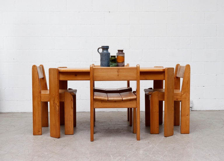 Midcentury Ate Van Apeldoorn style pine wood dining table with Angled Salt Legs. In Original condition with some moderate wear and scratching consistent with age and use. Shot with Ate Van Apeldoorn pine dining chairs (S439 AS).