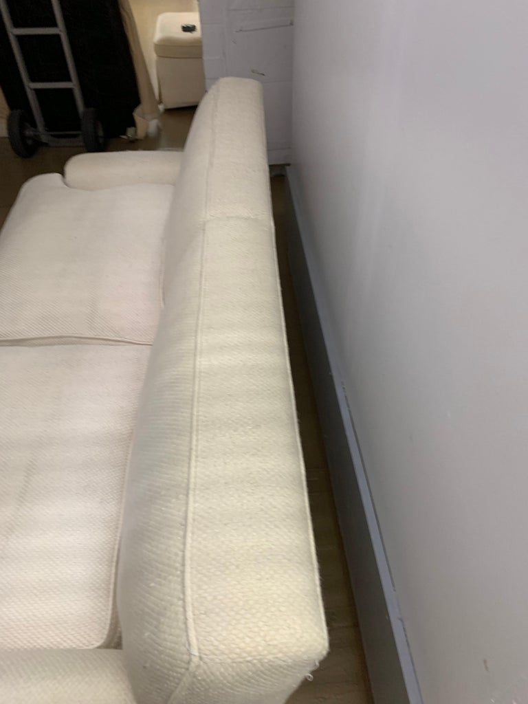 Midcentury Baker upholstered two-seat sofa or love seat Our living room furniture from our childhood home included this upholstered sofa along with an upholstered armchair and love seat of the same aesthetic upholstery is white cotton blend and