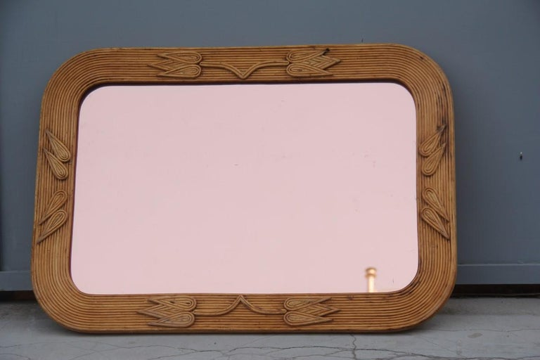 Midcentury bamboo wall mirror Vivai del Sud pink flower leaves rectangular. The mirror is very rare because it cannot be found, and the frame is completely handmade by skilled artisans who no longer exist, the mirror can be hung either vertically