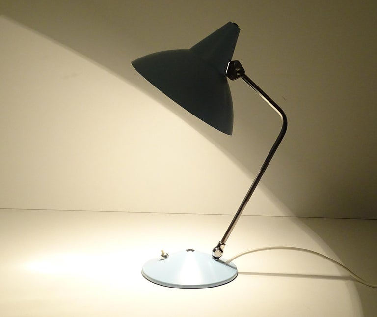 Midcentury table / desk lamp by Helo with signature witch Hat cap, the stem and shade´s angle are both adjustable, pastel blue enameled shade and base, chromed stem Rewired and ready for use in any country of the world.  It comes with a standard