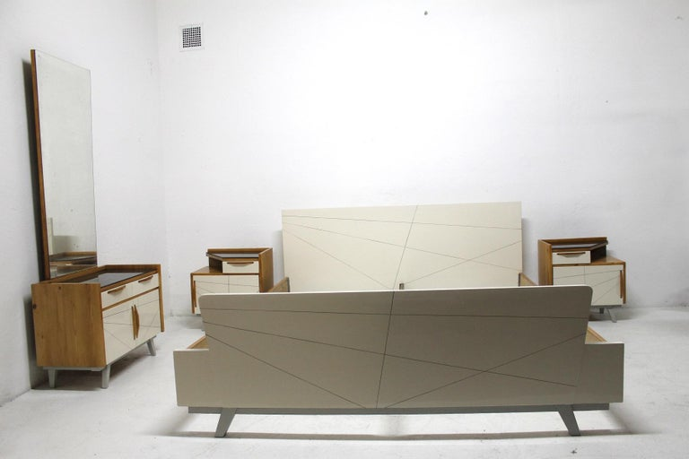 This bedroom set is a beautiful and characteristic example of Czechoslovak furniture design in connection with the so-called Brussels period. This period began with the huge success of the Czechoslovak Pavilion at the world-famous Expo in Brussels