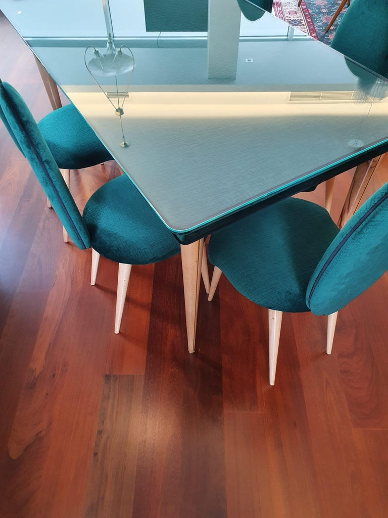Midcentury beech wood and fabric dining table & six chairs by Umberto Mascagni, 1950s.  Dining table and 6 chairs by Umberto Mascagni, from the Turin series, 1950s. Green-colored velvet tabletop with black trim on the edge. Beech wood conical