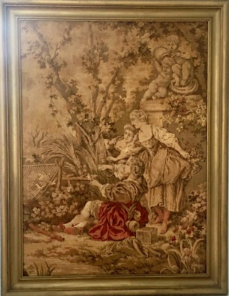 Mid-Century Belgium hanging framed tapestry, signed. This gorgeous wool golden hue tapestry is framed in a giltwood frame. Features a 17th century trio of women in the garden motif. Signed on the underside, Made In Belgium.