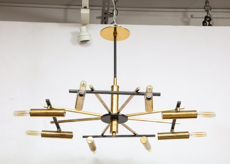 Vintage mid-century black and brass ceiling light by Stilnovo, Italy, c. 1950s.   This elegant light fixture has been newly rewired for US electrical and comes with a set of tubular incandescent filament bulbs.