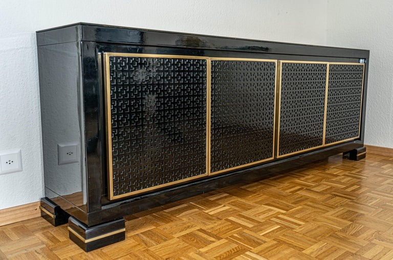 Late 20th Century Midcentury Black Lacquered Italian Credenza with Gold Leaf Glass Top For Sale