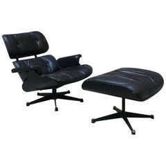 Midcentury Black Rosewood and Leather Lounge Chair and Ottoman by Eames, 1958