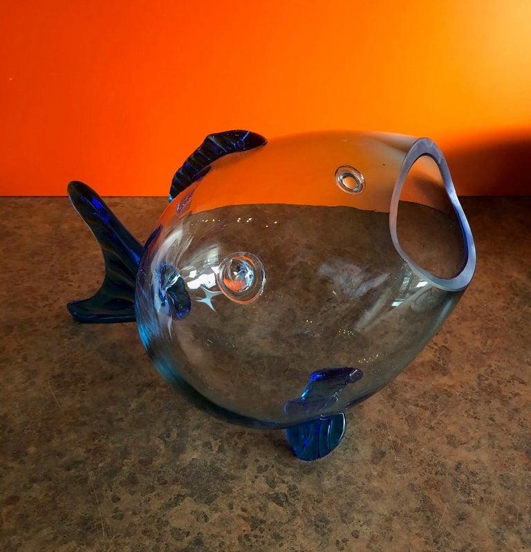Fun midcentury glass fish vase by Blenko, circa 1970s. The vase is 15.25