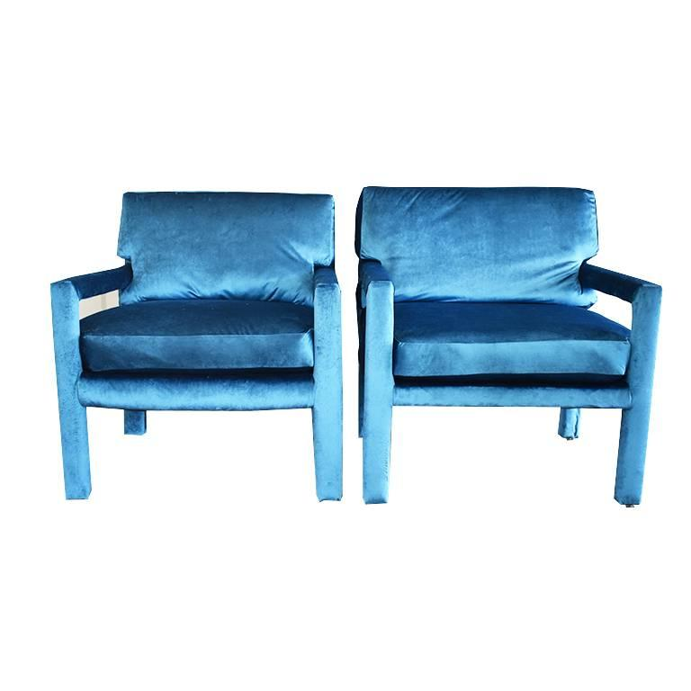 Pair of midcentury blue velvet Milo Baughman style armchairs. Newly upholstered in a buttery soft blue velvet fabric. (Jewel tones are all the rage in 2018) The back cushions on the chair are cut into accommodate the side arms, and are removable.