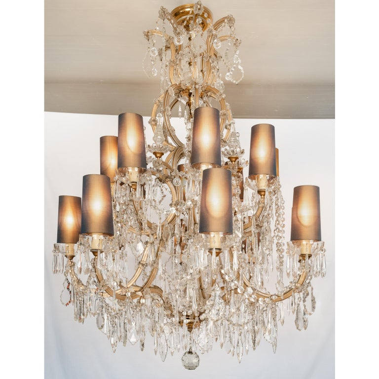 Mid-century Bohemian Marie Therese Baccarat Style 16 Light Crystal Chandelier, 1930's. Rare and large Italian Marie Therese sixteen light crystal chandelier with a shaped central stem surmounted by beautifully contoured scrolling arms. These lovely