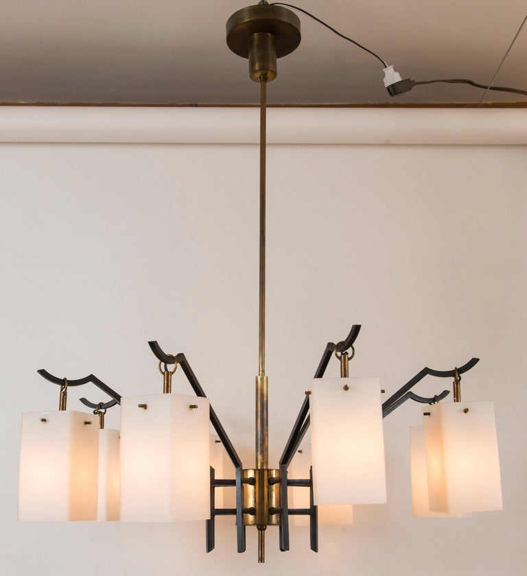 Elegant mid century Italian solid brass chandelier with six angular outstretching arms holding rectangular shaped satin opaque white glass shades attributed to Stilnovo, illumination is beautiful, re-electrified to code with new brass candelabra