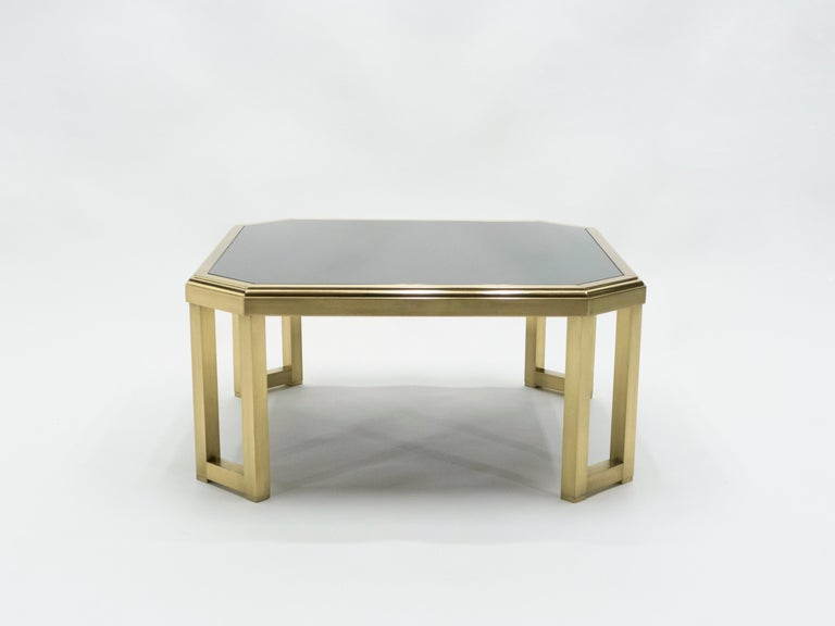 This table's beautiful, polished brass base and feet reflect the Chinese-inspired design that dominated many creations by Maison Jansen. Mid-Century Modern elements like sleek, clean lines are given an ornamental flare, with a brand new black