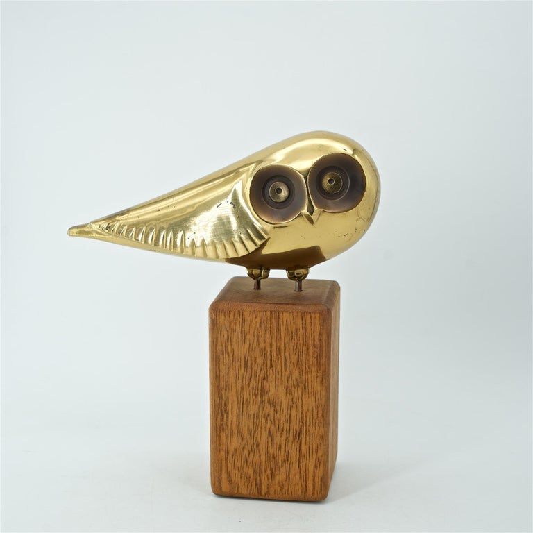 Rare series from the Curtis Jere Artisan House, USA, circa 1981, owl on wood plinth.