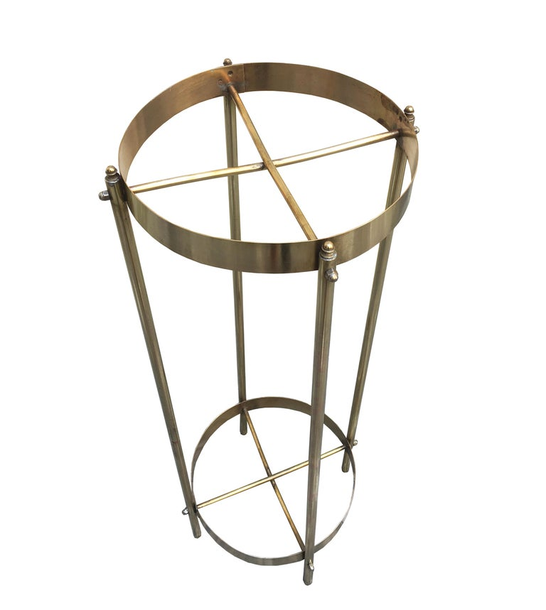 Beautiful brass plant holder made in Italy in the 1960s. It is in polished brass with 2 shelves, which can also be used as an elegant pedestal.