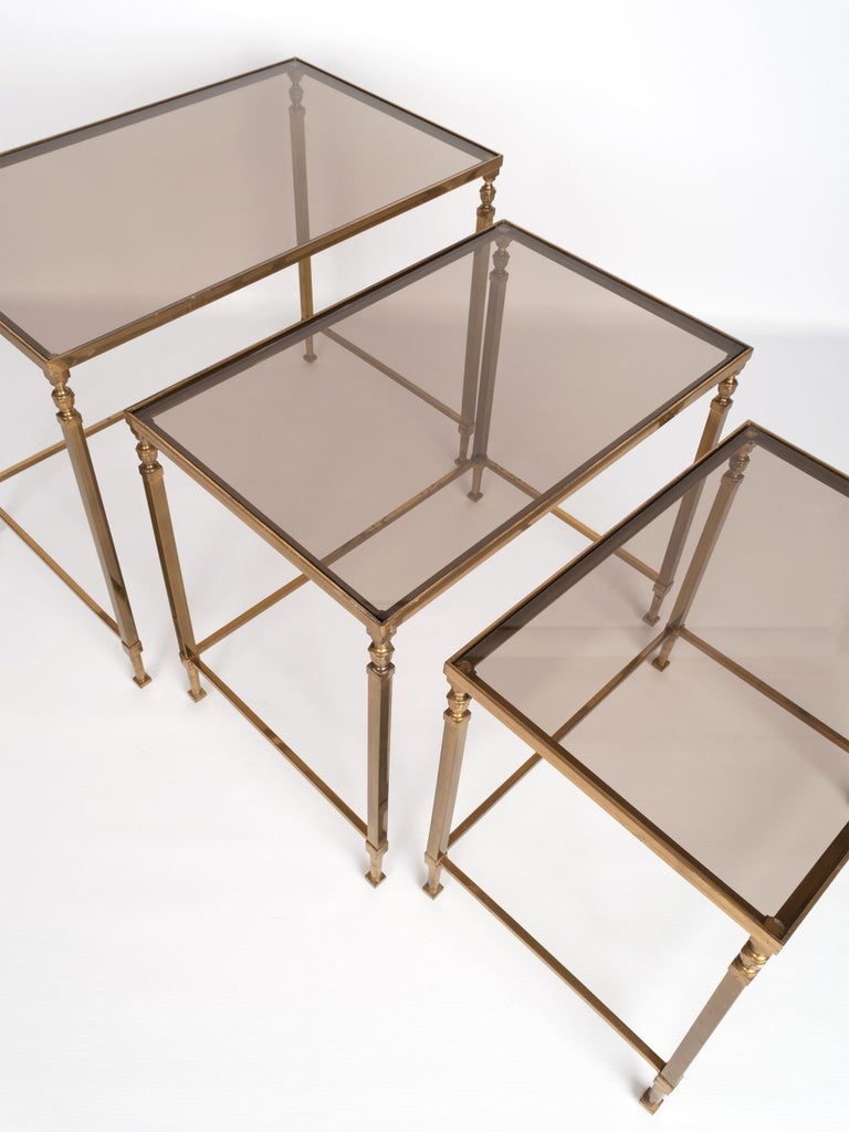 Midcentury Brass and Smoked Glass Nesting Tables by Maison Baguès, France In Good Condition For Sale In London, GB