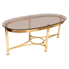 Midcentury Brass and Smoked Glass Oval Coffee Table, Italy, circa 1960