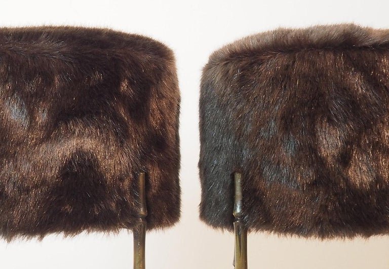 Three beautiful brass stools re-covered with very soft new faux fur (Faux Mink) - The slender Brass legs simulate bamboo, and the perfect proportions with high padded top give a lot of elegance to this piece.  Three availbls.