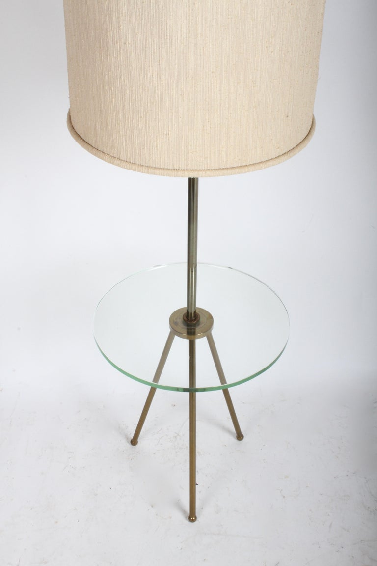 Mid-Century Modern Italian Brass Floor Lamp with Tripod Legs and Glass Shelf In Good Condition For Sale In St. Louis, MO