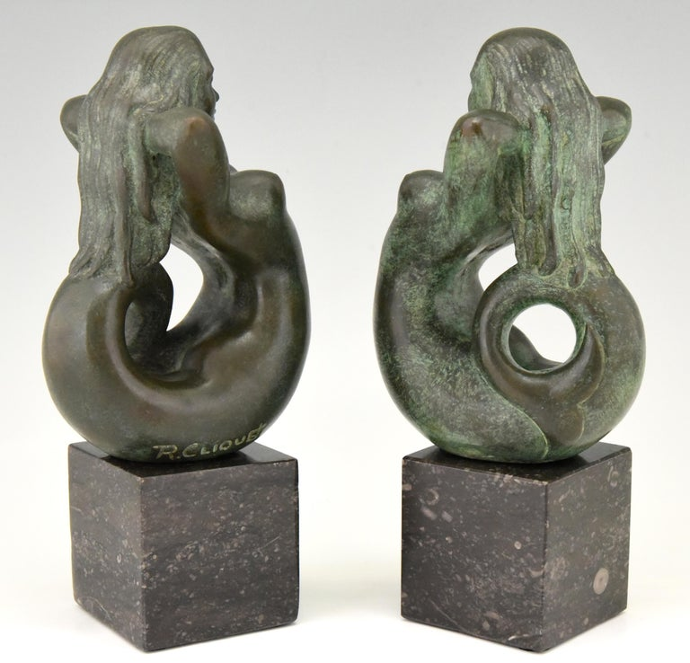 Lovely pair of midcentury bronze mermaid bookends  Signed by the Belgian artist Rene Cliquet, 1899-1974 The bronze figures are mounted on marble bases.