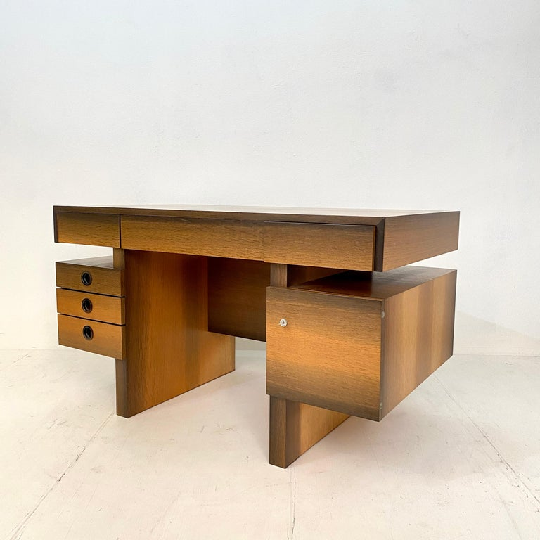 Thismid century brutalist desk in bog oak veneer and mahogany was made in 1972 for a house in South Germany. It is one of a kind and done beautifully by the carpenter.  As the writing table was not used a lot it is in perfect condition.  It can