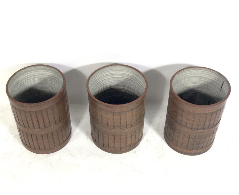 Midcentury ceramic planters, American, circa 1960s. These pieces are unsigned, so we are unsure of the ceramicist, but the estate where they were purchased from told us they were purchased in California. They have clean lined incised decoration and