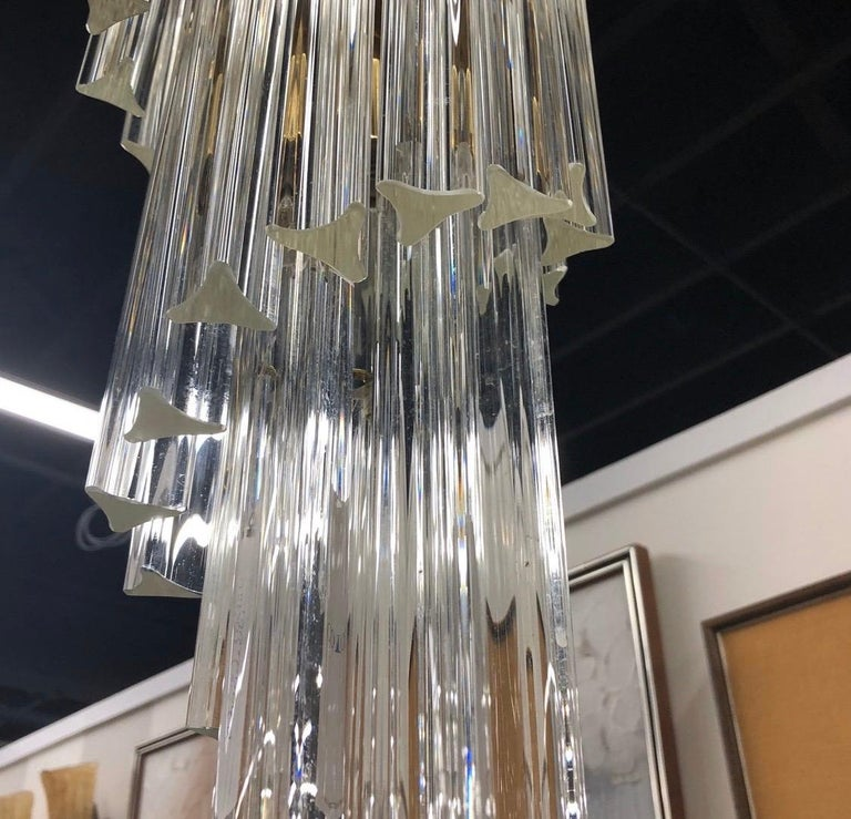 Stunning Mid-Century Modern Camer Murano glass waterfall chandelier that is fifty-five tall. It is unusual to see chandeliers this tall. Would look perfect in almost any environment.