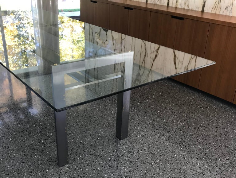 "The Doge table, designed by Carlo Scarpa, one of the cornerstones of the ""Ultrarazionale"" movement. Solid brushed steel supports connected with allen screws and brass inset spacers, 1/2"
